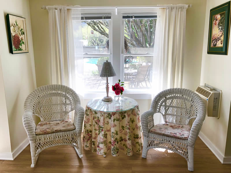 garden room with two chairs and a table
